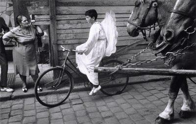 Josef Koudelka's angel boy on bicycle