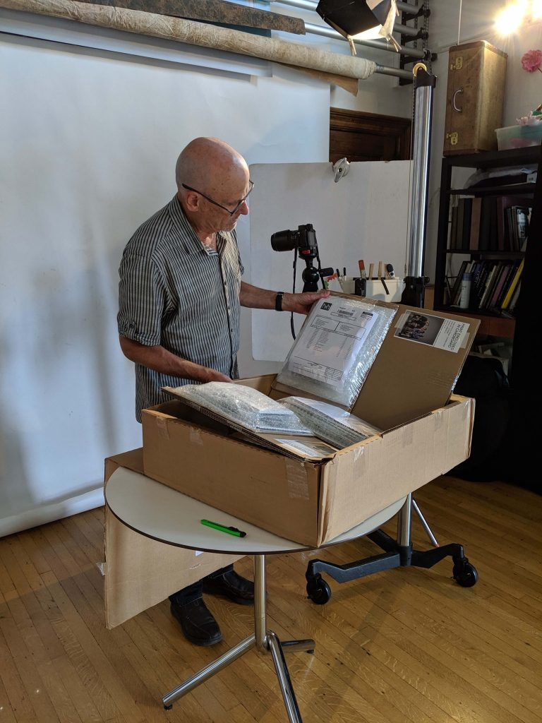 Phil Cantor unpacking portraits